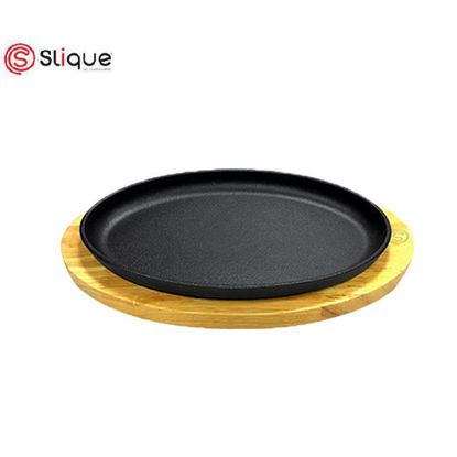 Picture of Slique Premium Cast Iron Oval Sizzling Plates with Original Rubber Wood Base 29cm